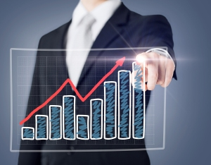 business and technology concept - businessman hand with chart on