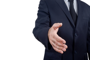 Businessman Holds Out His Hand To Make A Deal